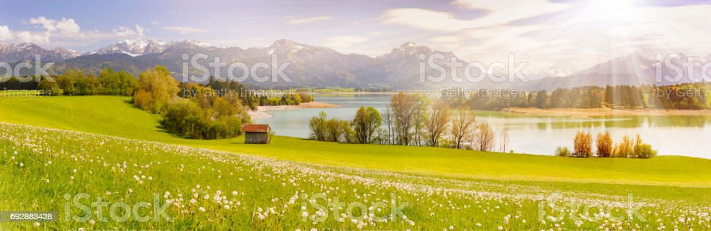 panorama landscape in Bavaria with meadow, alps mountains and lake stock photo