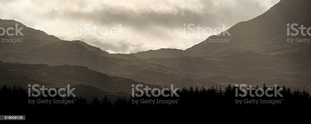 Panorama landscape sunrise over distant misty mountains with sun stock photo