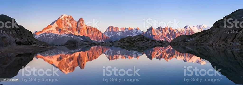 Panorama of Alps mountain with sunset light reflecting in lake stock photo