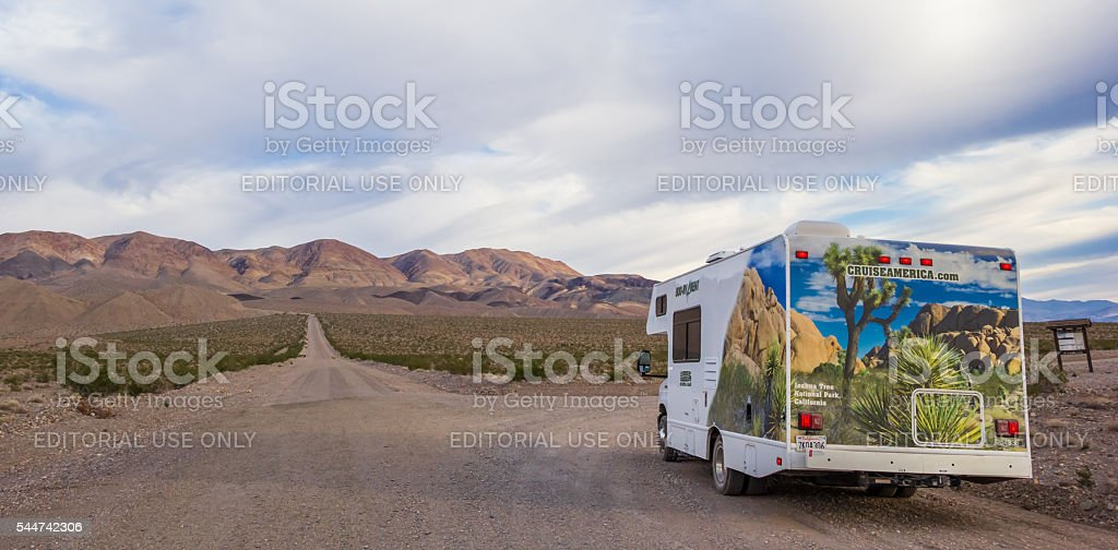 Panorama of an RV at gravel road in Death Valley stock photo