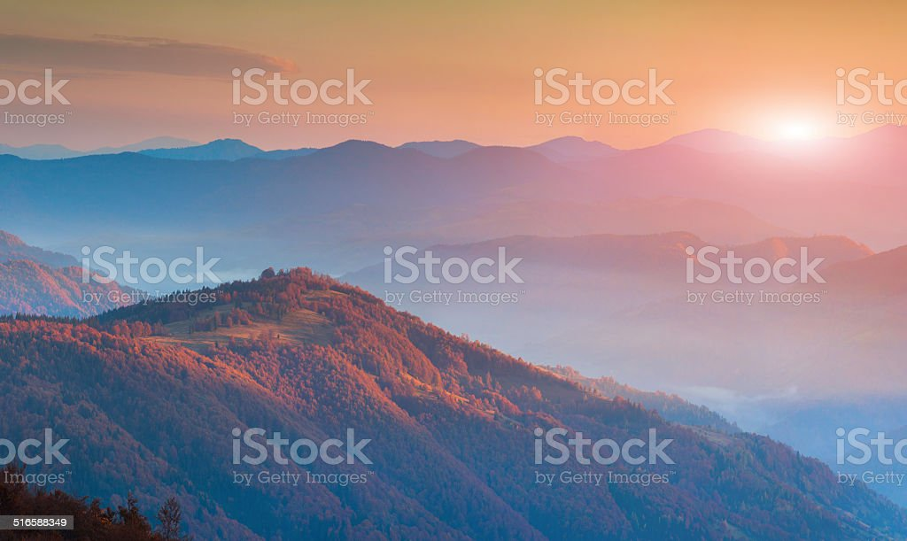Panorama of autumn mountains in the morning mist stock photo