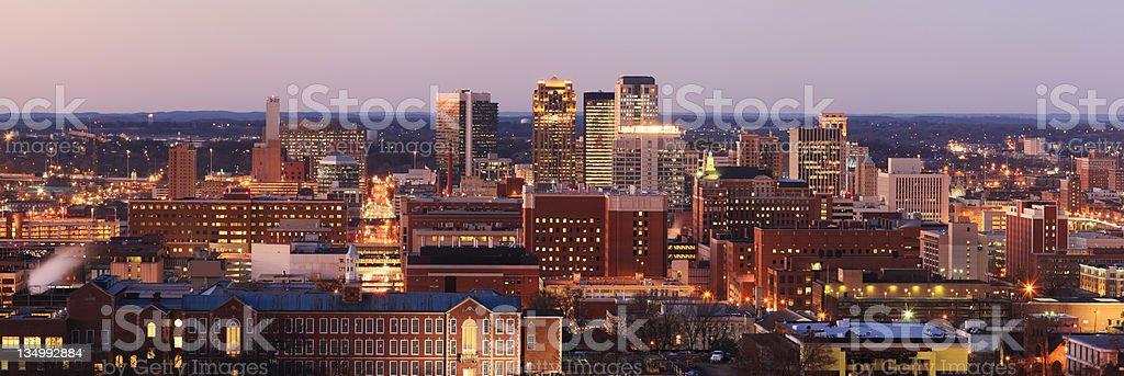 Panorama of Birmingham, Alabama illuminated at dusk stock photo