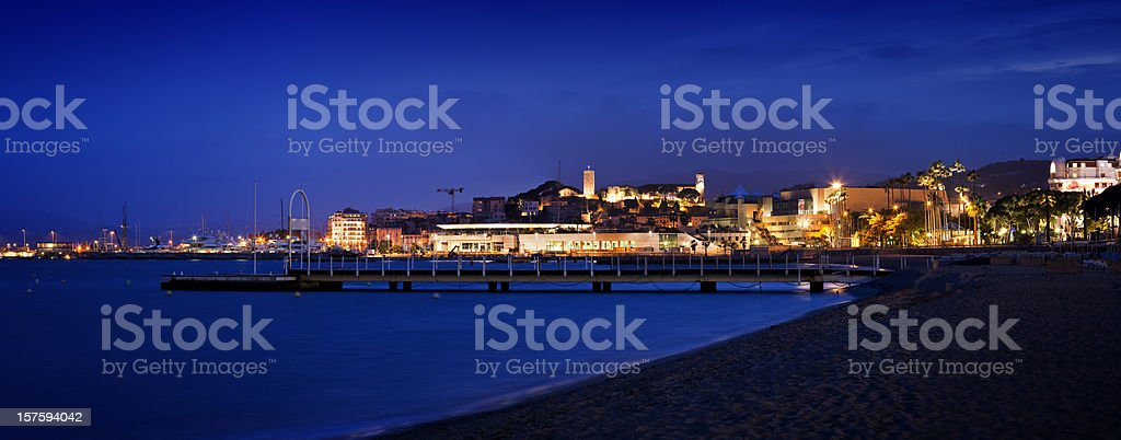 Panorama of Cannes with marine by night royalty-free stock photo
