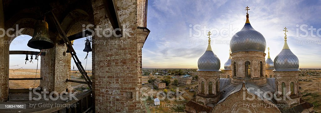 Panorama of church and bell tower in village Nikolsky, Russia stock photo