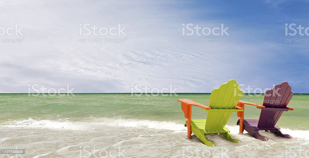 Panorama of Colorful chairs at a tropical beach royalty-free stock photo