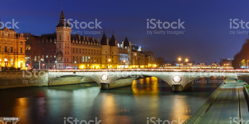 Panorama of Conciergerie at night, Paris, France stock photo