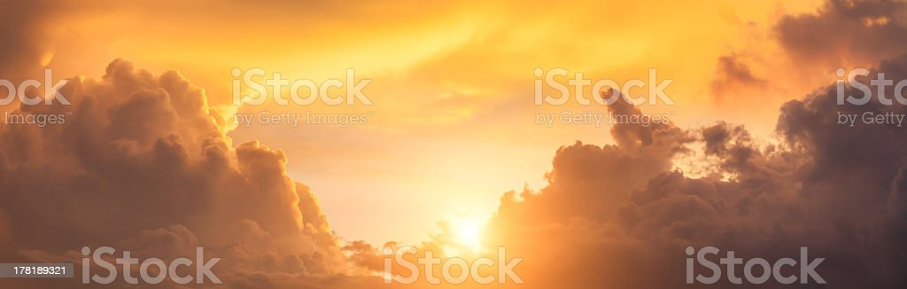 Panorama of dramatic orange clouds in the evening sky stock photo