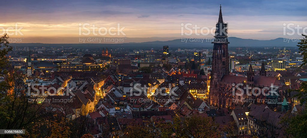 Panorama of Freiburg im Breisgau after sunset stock photo