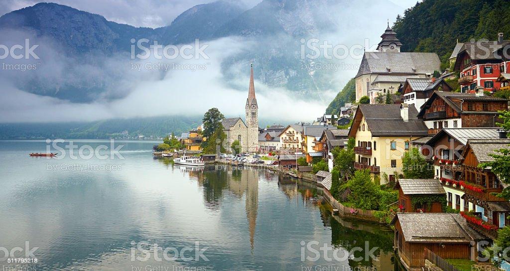 Panorama of Hallstatt mountain village. Foggy morning stock photo