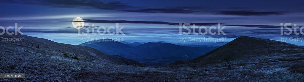 panorama of hillside with stones in high mountains at night stock photo