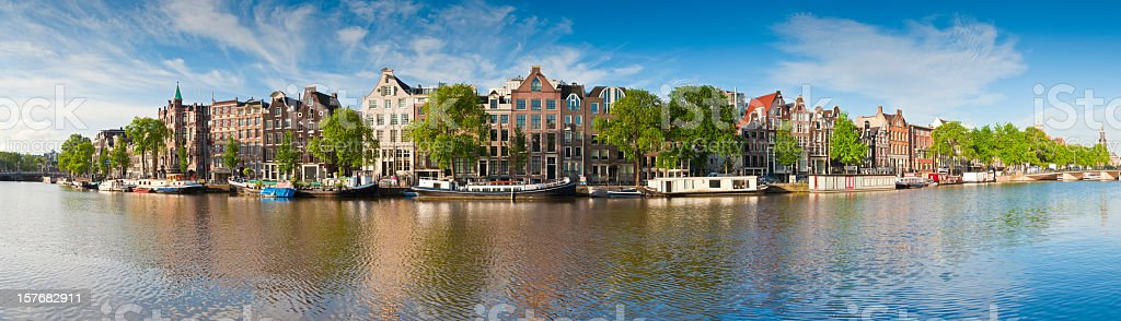 Panorama of house lining a canal in Amsterdam stock photo