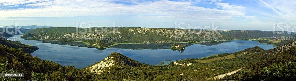 Panorama of Krka river, the island and monastery Visovac stock photo