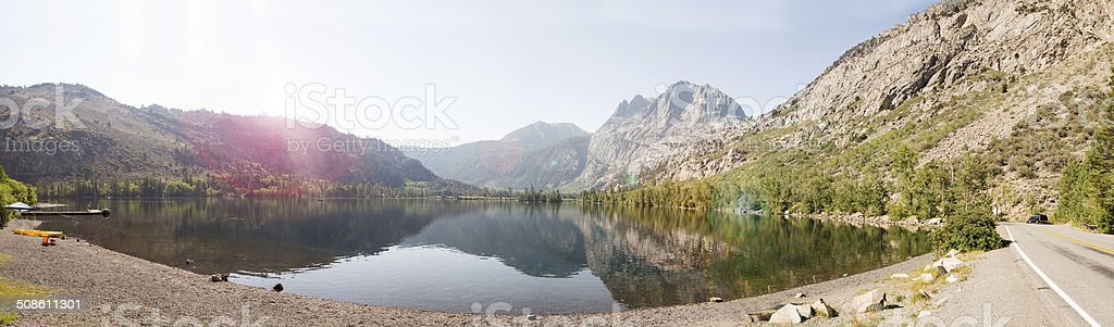 Panorama of Lake with Mountains showing lens flare stock photo
