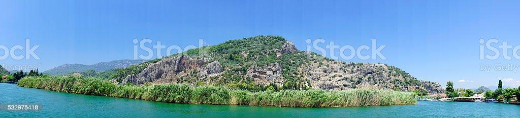 Panorama of Lykian  tombs in the rocks. stock photo