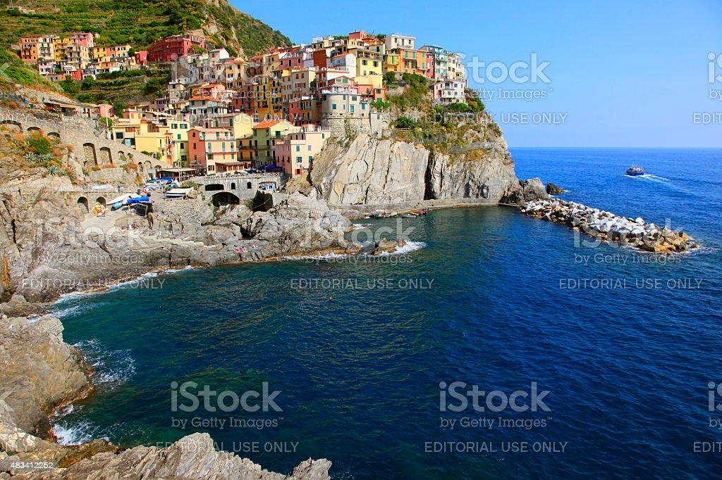 Panorama of Manarola colorful buildings and harbor, Liguria, Italy stock photo