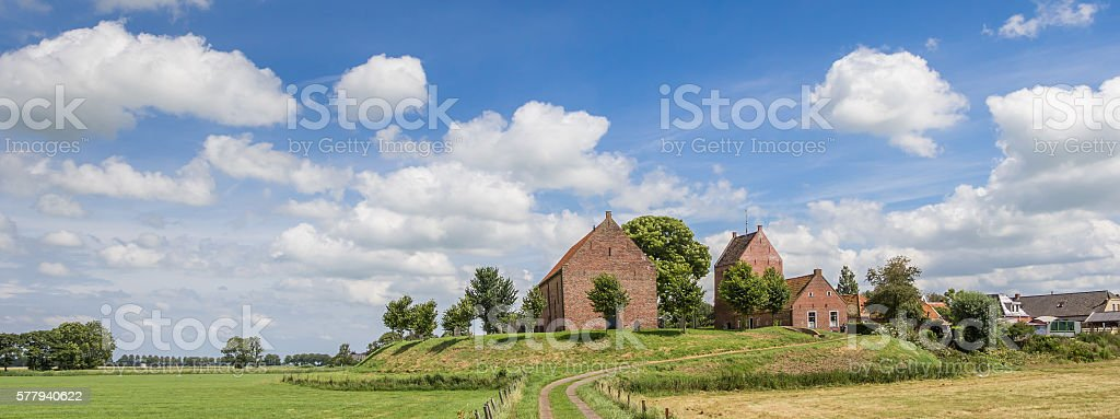 Panorama of medieval church of the Groningen village Ezinge stock photo