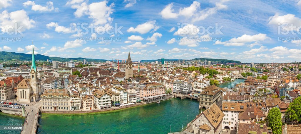 Panorama of Minster Fraumunster and St. Peter church with city center of Zurich, Switzerland - aerial view stock photo