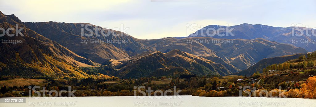Panorama of Mountain alpine alps range at Lake Hayes Queenstown stock photo