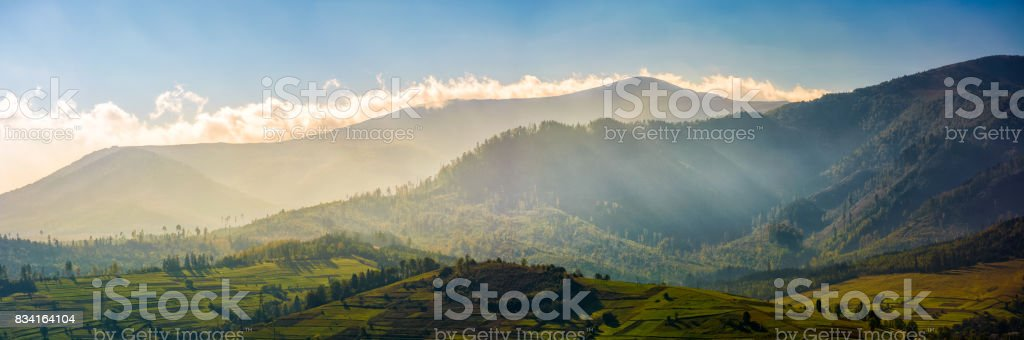 panorama of mountainous rural area at sunrise stock photo