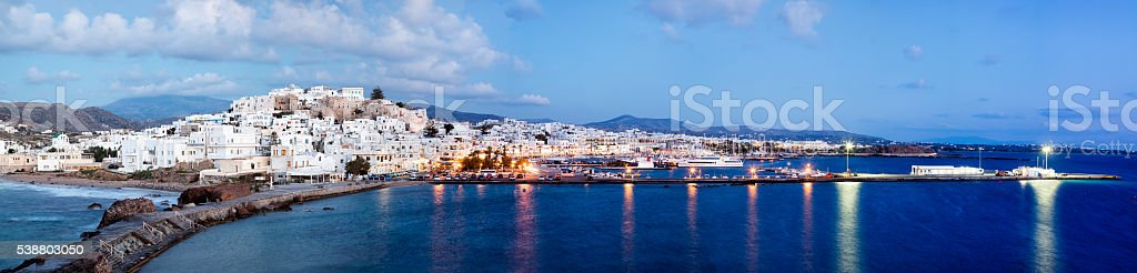 Panorama of Naxos Illuminated at Dusk, Cyclades, Greece stock photo