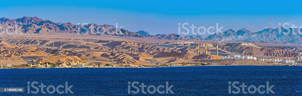Panorama of oil refinery on Red Sea rocky coast stock photo
