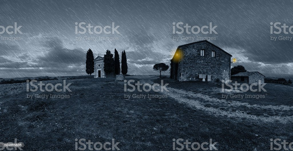 Panorama of old chapel rainy night stock photo