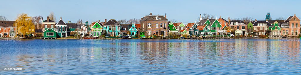 Panorama of old dutch traditional houses in Zaanse Schans and stock photo
