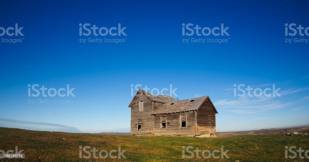 panorama of old farmhouse in the Prairies stock photo