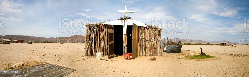 Panorama of poor African church in the desert stock photo