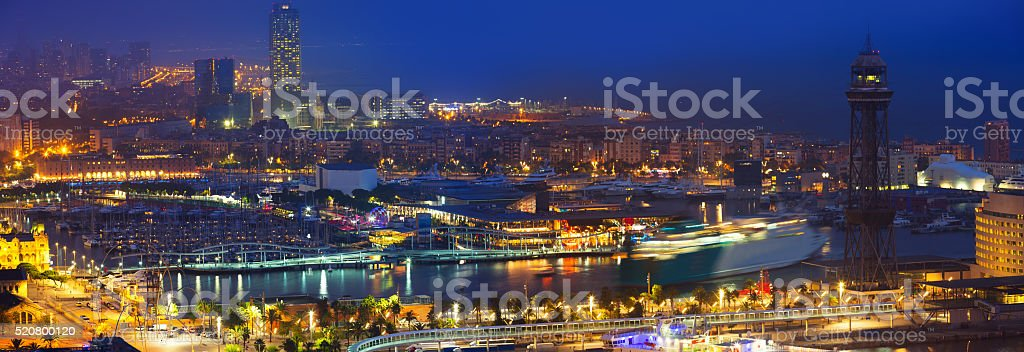 Panorama of Port Vell at Barcelona in night stock photo