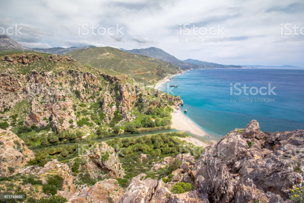 Panorama of Preveli beach at Libyan sea, river and palm forest, southern Crete , Greece stock photo