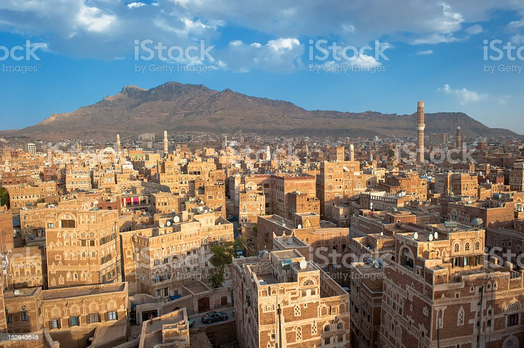 Panorama of Sanaa Yemen showing many buildings and mountain stock photo