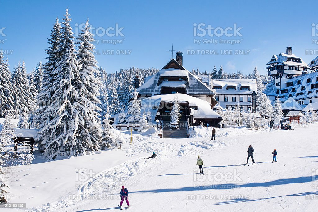 Panorama of ski resort Kopaonik, Serbia, people, houses covered with stock photo