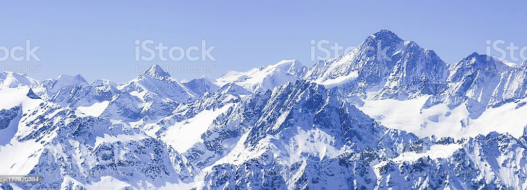Panorama of Snow Mountain Range Blue Sky from Switzerland royalty-free stock photo