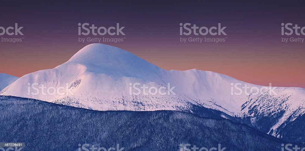 Panorama of snowy summit at winter morning royalty-free stock photo