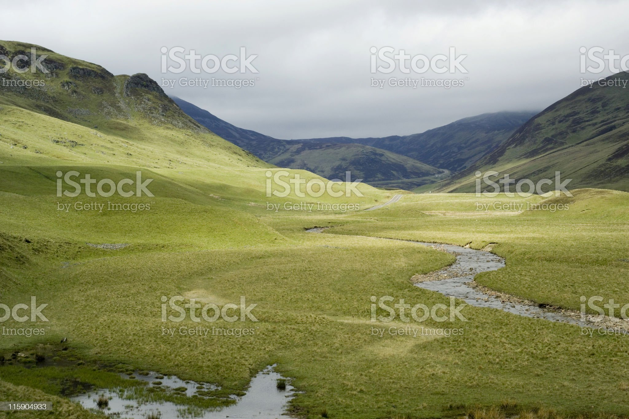 Panorama of spacious Scottish valley on a cloudy day royalty-free stock photo