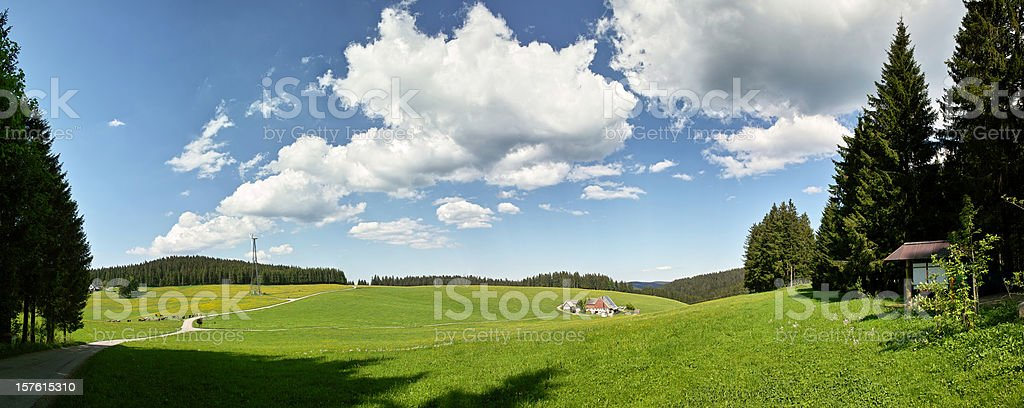 panorama of Summerday in Black Forest with meadow and farm royalty-free stock photo
