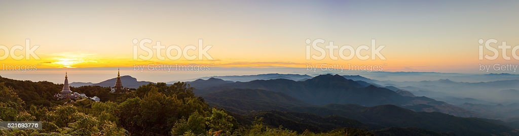 Panorama of Sun rise at Pagoda onmountain stock photo