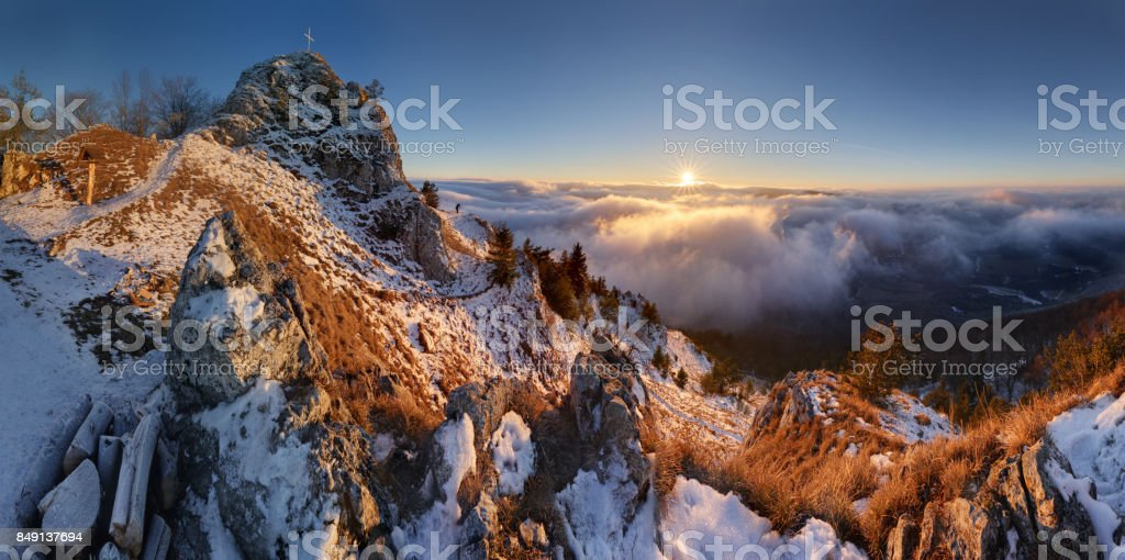 Panorama of sunset in a Carpathian mountain valley with wonderful gold light on a hills stock photo