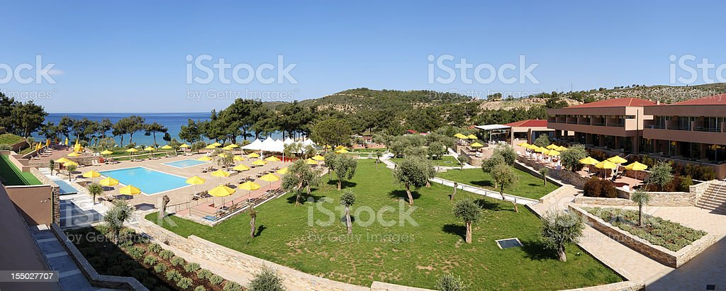 Panorama of swimming pools and beach at the luxury hotel royalty-free stock photo