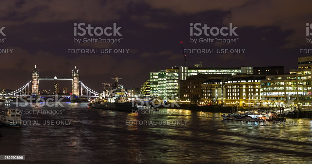 Panorama of Thames river docks at night with Tower Bridge stock photo