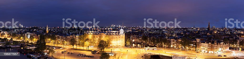 A panorama of the Amsterdam skyline at night royalty-free stock photo