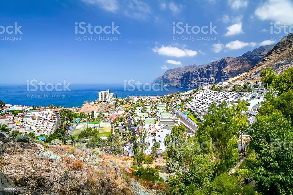 Panorama of the bay with mountain and village stock photo