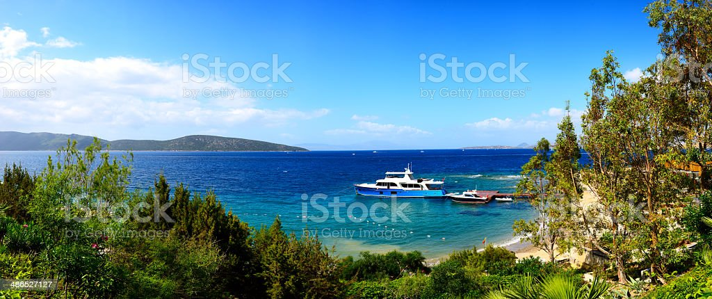 Panorama of the beach with recreation yacht stock photo