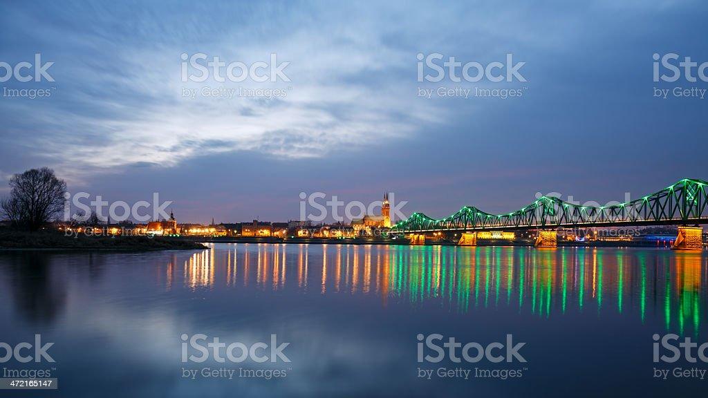 Panorama of the city and illuminated bridge at night stock photo
