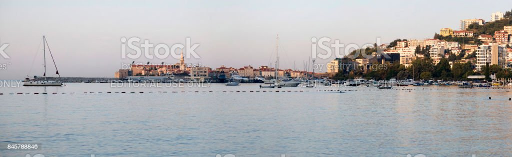 Panorama of the city of Budva in the rays of the rising sun. stock photo