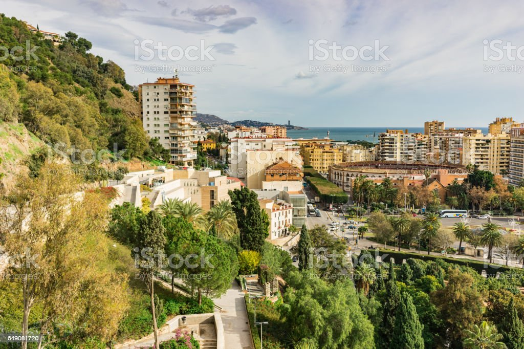 Panorama of the city of Malaga, Spain from the walls and towers of an ancient medieval part of the city stock photo