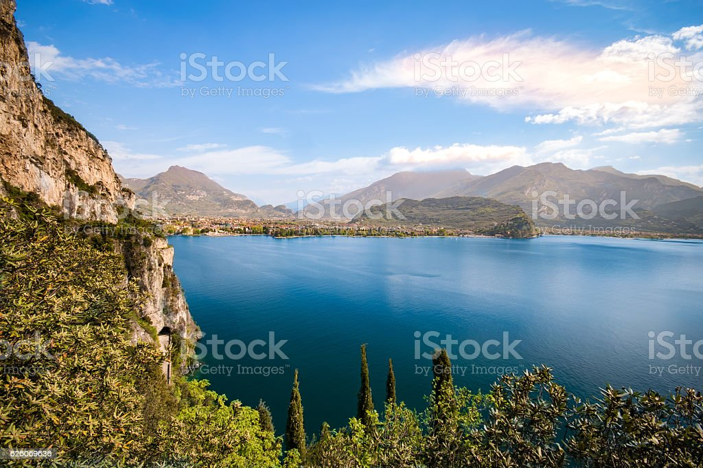 Panorama of the gorgeous Lake Garda surrounded by mountains. stock photo