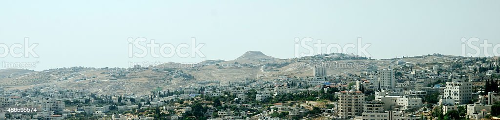 Panorama of the holy city Bethlehem and Herodium hill stock photo