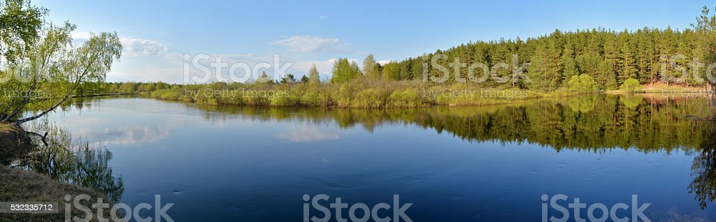 Panorama of the spring river. stock photo